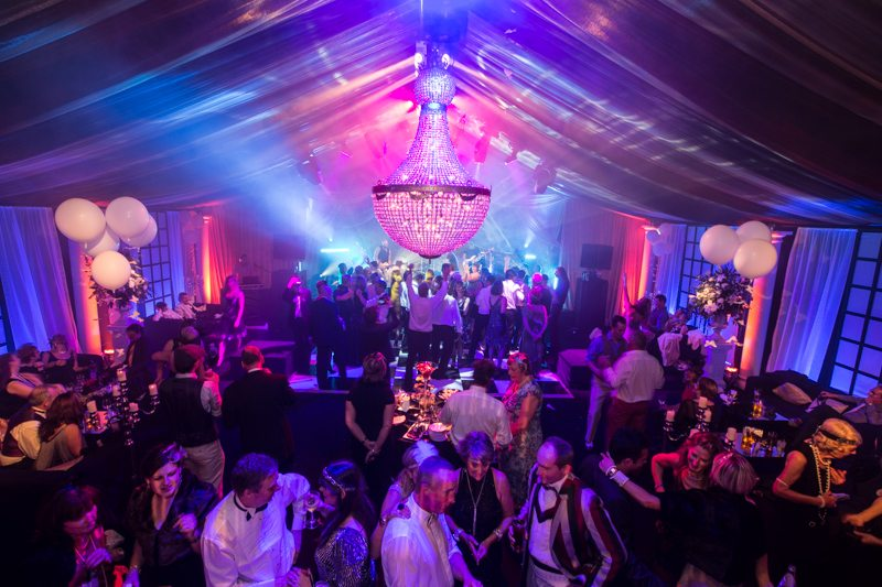 Interior Gatsby Mansion Party with Giant Chandelier