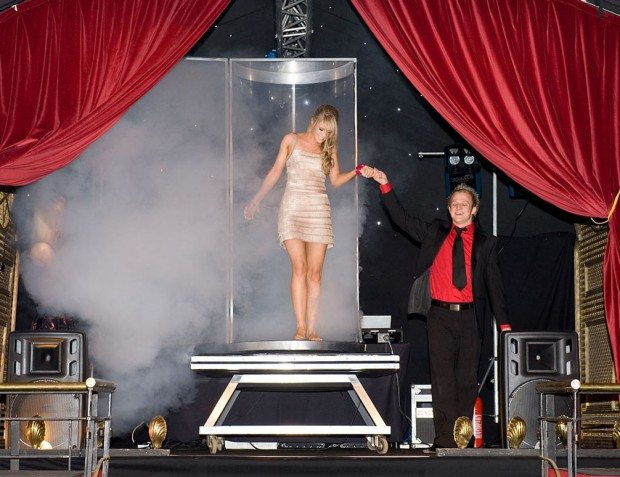 Magician Performing Act With Guest