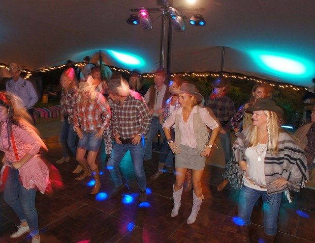 guests Line Dancing At Wild West Party