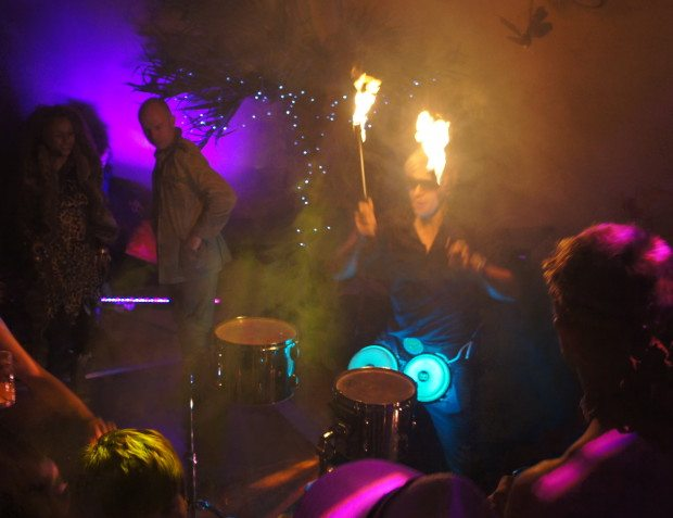 Drummer With Fire At African Themed 50th