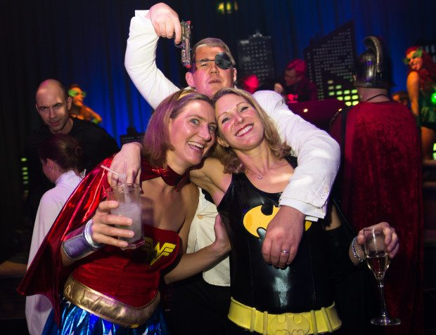 Guests At Heroes And Villains Themed Party
