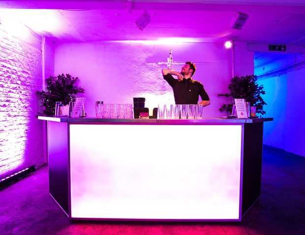 Mixing Drinks On Lit Up bar