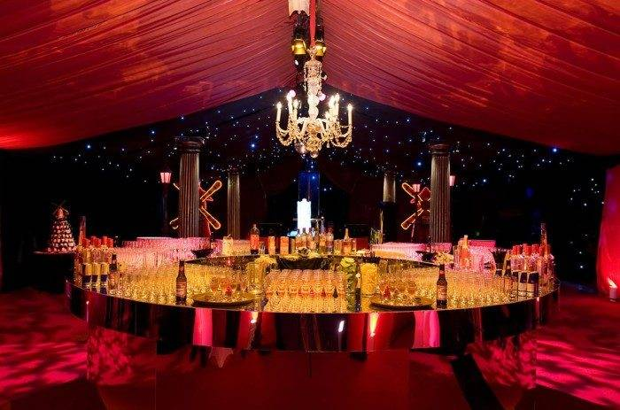 Moulin Rouge party circular bar and starcloth
