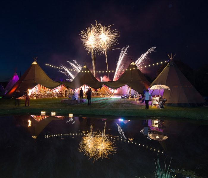 Fireworks over Giant Tipi at Festival themed party