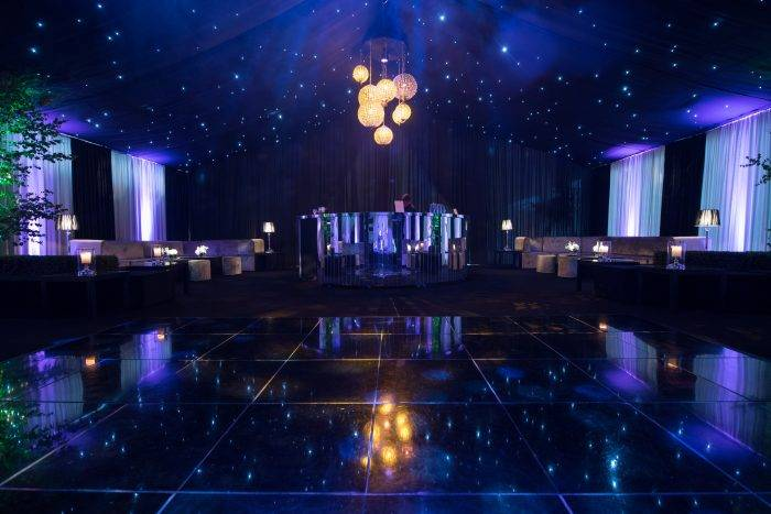 Private Party Marquee with Star cloth ceiling, dance floor and mirrored bar