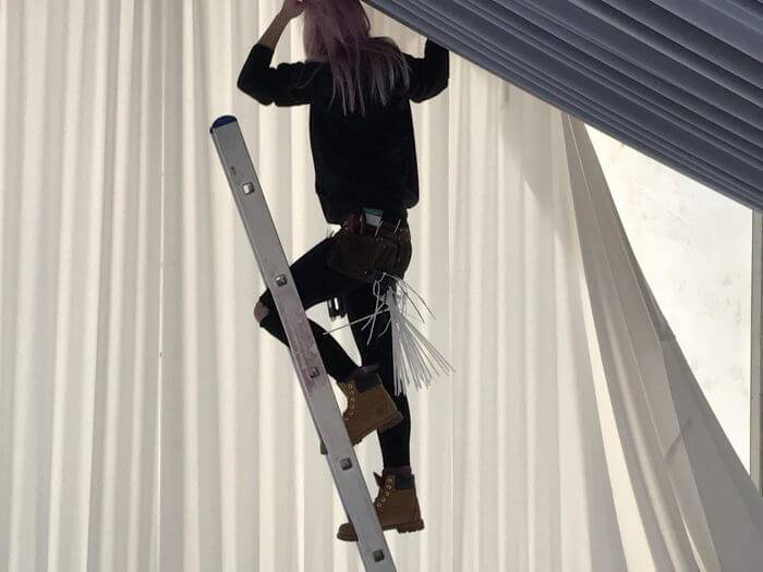 A professional draper on site at a party marquee