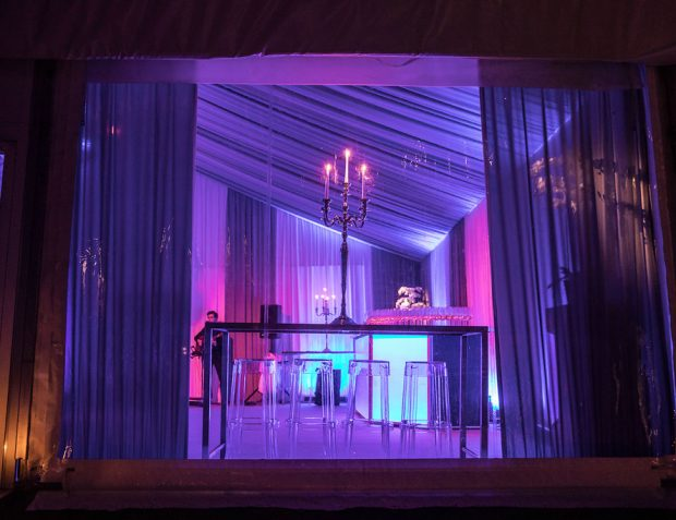 looking into interior of party with draping and furniture