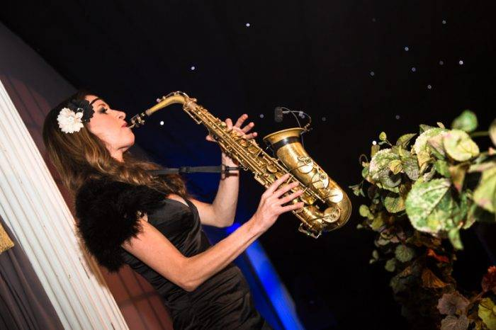 Iconic saxophonist plays atmospheric tunes whilst guests socialise at a 1920s Gatsby inspired private party
