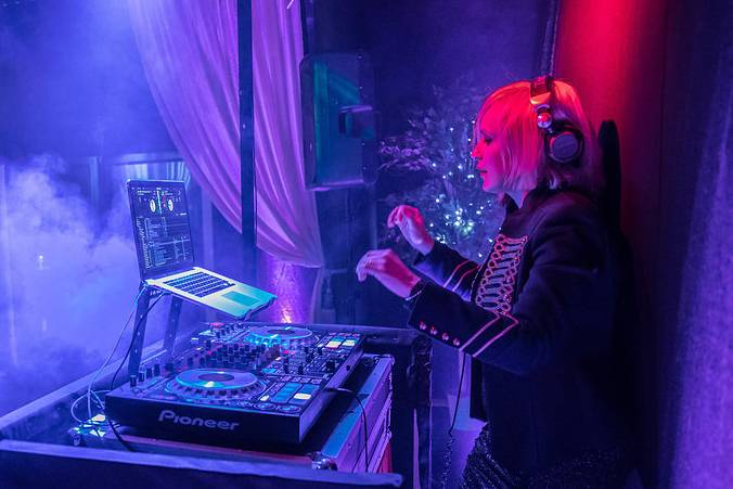 DJ producing ultimate party mix at cool party