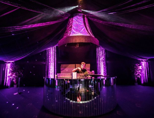 The Rage Pop-Up Nightclub with mirrored bar and bar tender
