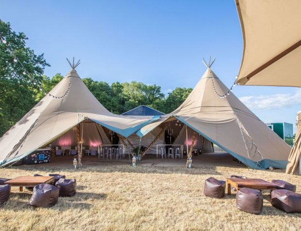 Two Giant Hat Tipis corporate summer party