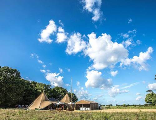 Beautiful exterior shot of Mirage Parties corporate event set up marquee party with giant tipis and blue sky vista