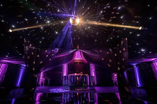 Rage pop up nightclub featuring mirror ball and intelligent lighting