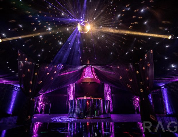 Rage Pop-Up Nightclub interior with circular mirrored bar, mirror ball and lights