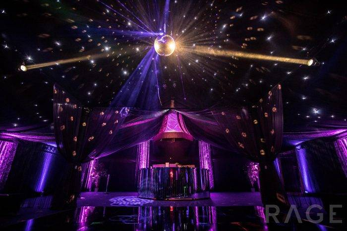 Rage Pop-Up Nightclub interior with circular mirrored bar, mirror ball and lights