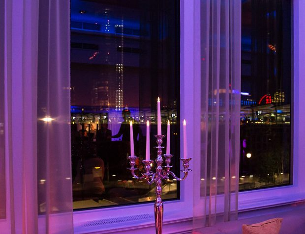 River Rooms London by night with candelabra looking of window to River Thames