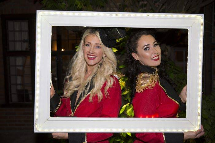 Two ladies with LED photo frame