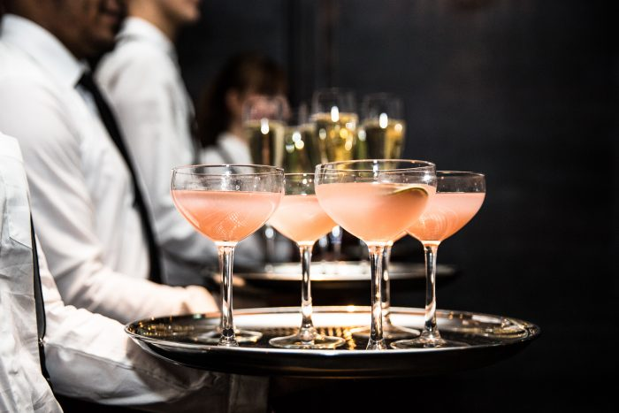 Pink drinks on tray waiter service