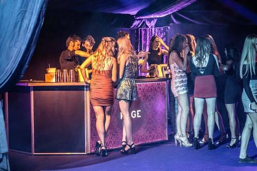 Party guests at the Rage Pop-Up Nightclub bar