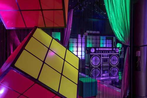 Boombox and giant rubics cube at a 80th themed birthday party