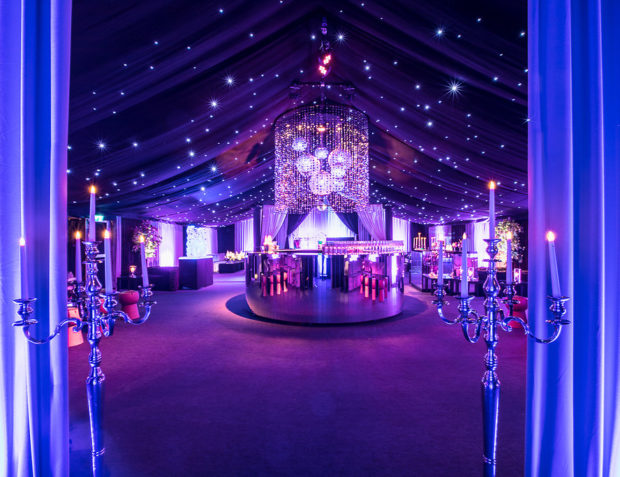 High-end marquee entrance with draping and candelabras