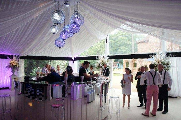 Party Marquee With Draping And Mirrored Circular Bar