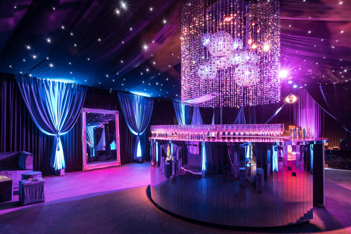 Interior luxury marquee with large circular mirrored bar