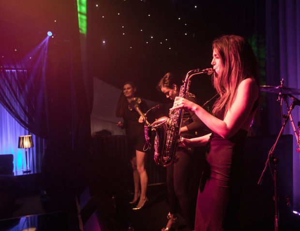 Sax player on stage at private party