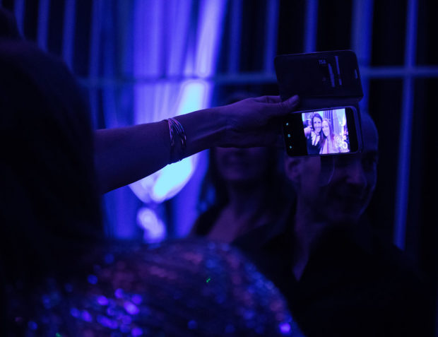 Guests take a selfie at Oceans 11 themed birthday party