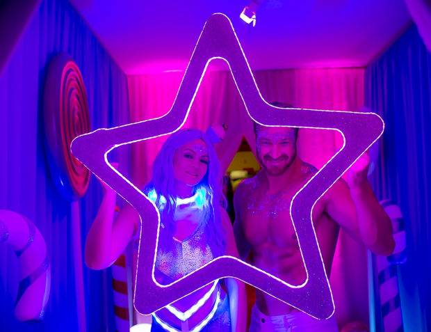 Two people in LED photo frame at Katy Perry California Gurls Themed Party
