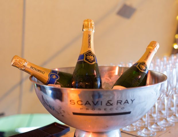 Three Champagne bottles in a Scavi & Ray ice bucket