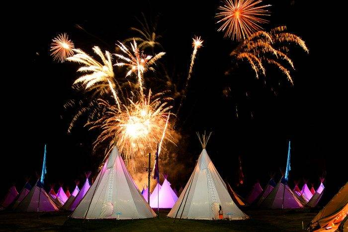 Fireworks And Lit Up Tipis