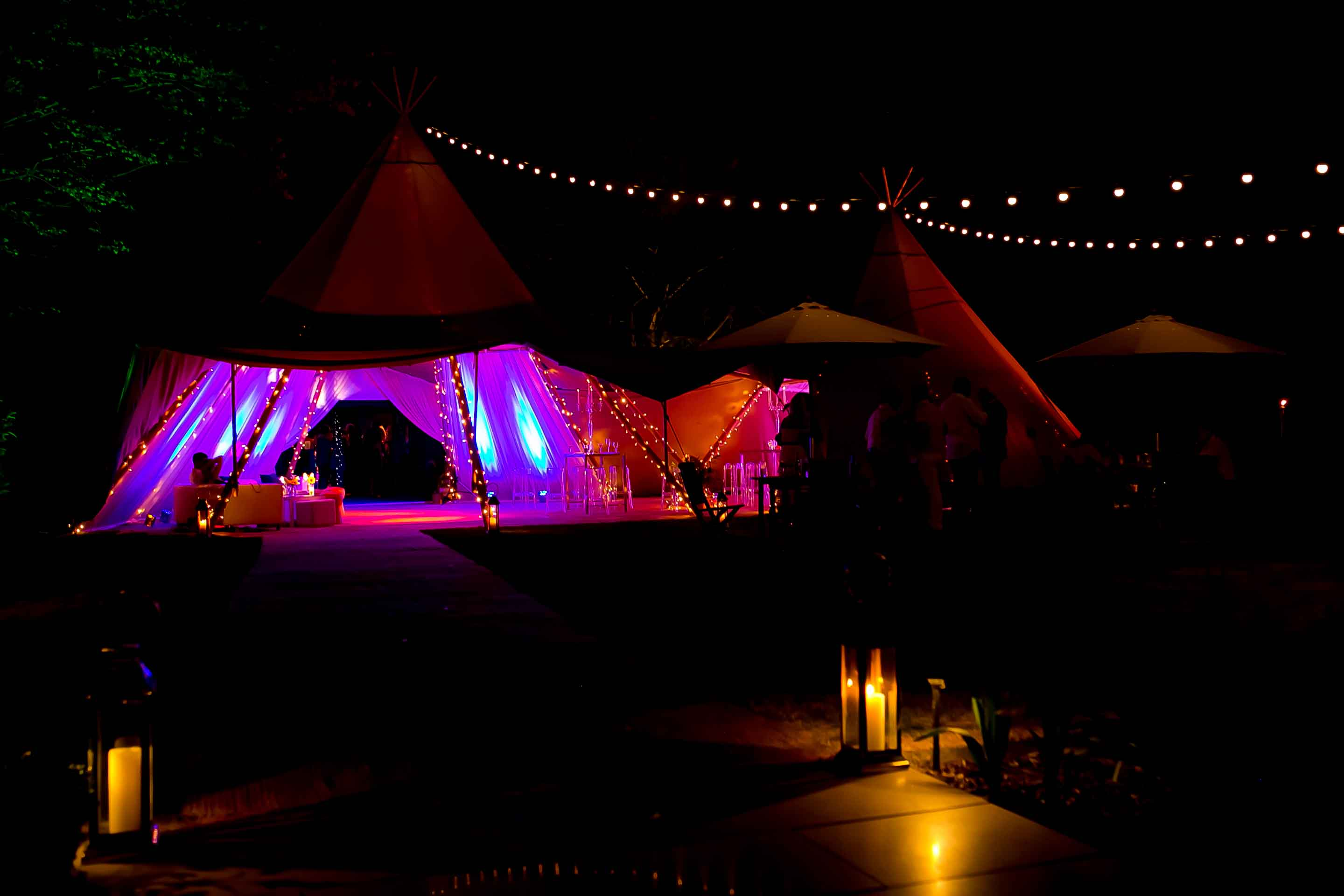 Giant hat tipi's by night with festoon lighting