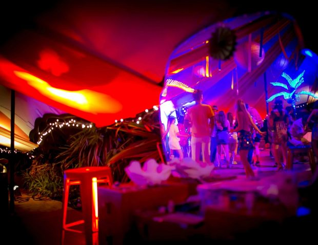 Guests dancing at a festival themed party