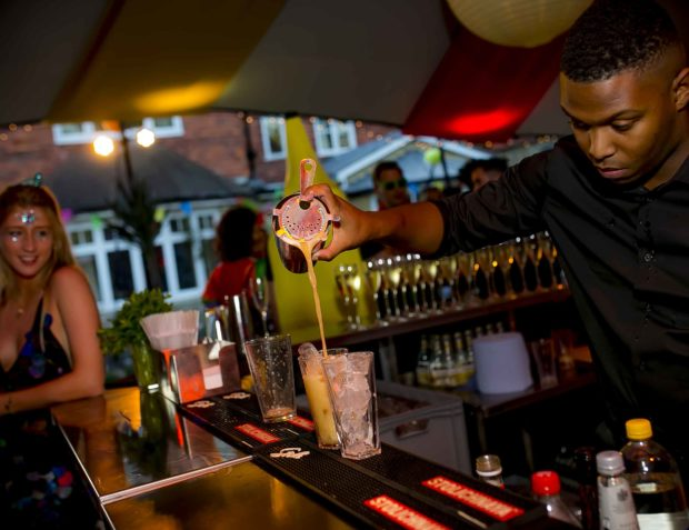 Barman pours drinks at a private party