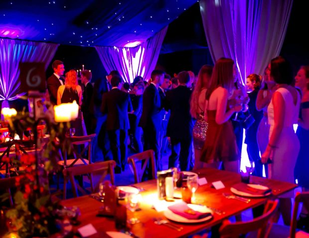 guests mingle in party marquee