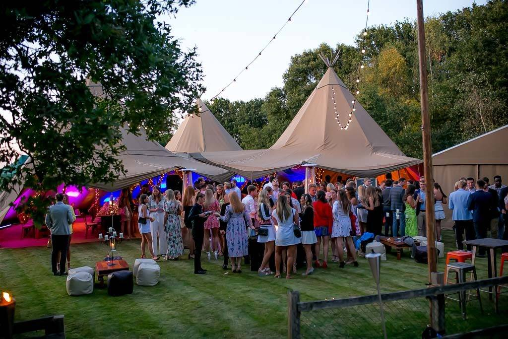 Drinks reception outside giant tipis in Essex