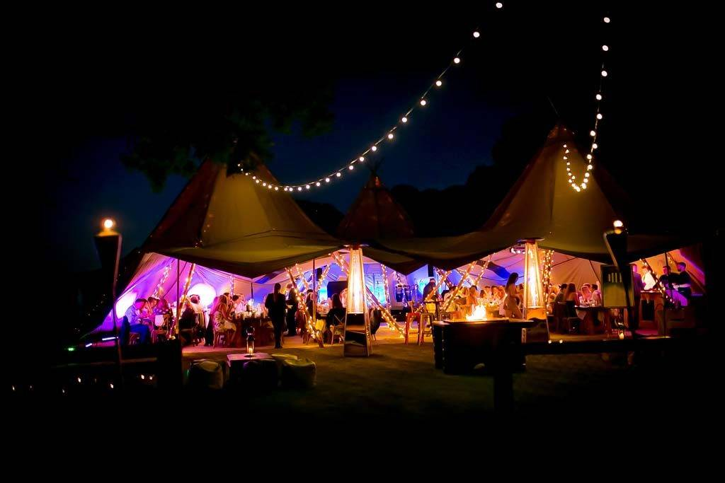Nighttime picture of giant tipis at an Essex 21st dinner party