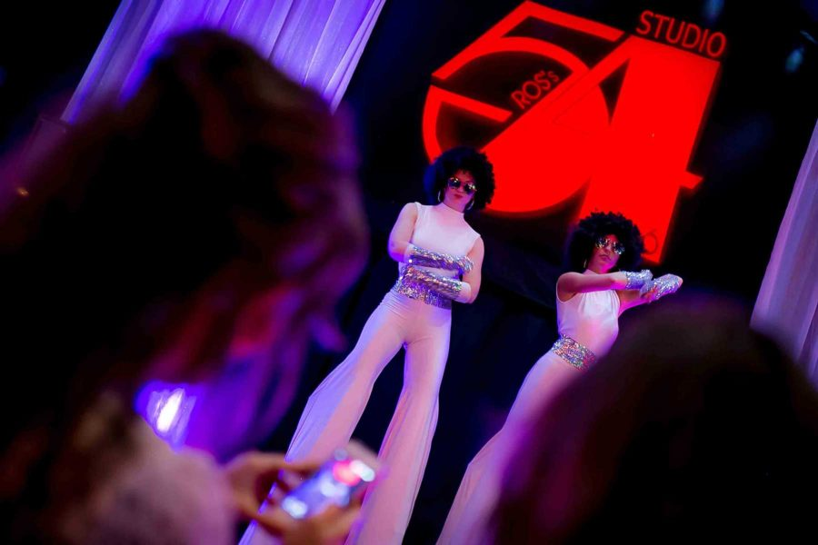 studio 54 themed party stilt acts