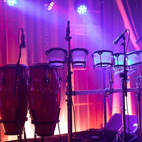 LED bongo drums set up on stage with lighting for private party