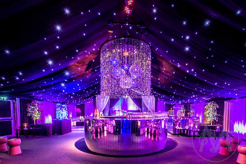Mirrored bar at a private party with luxury star cloth draping
