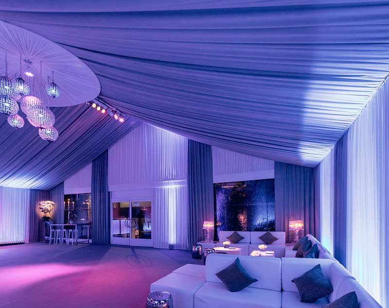 Christmas party in a marquee with draping and crystal chandeliers