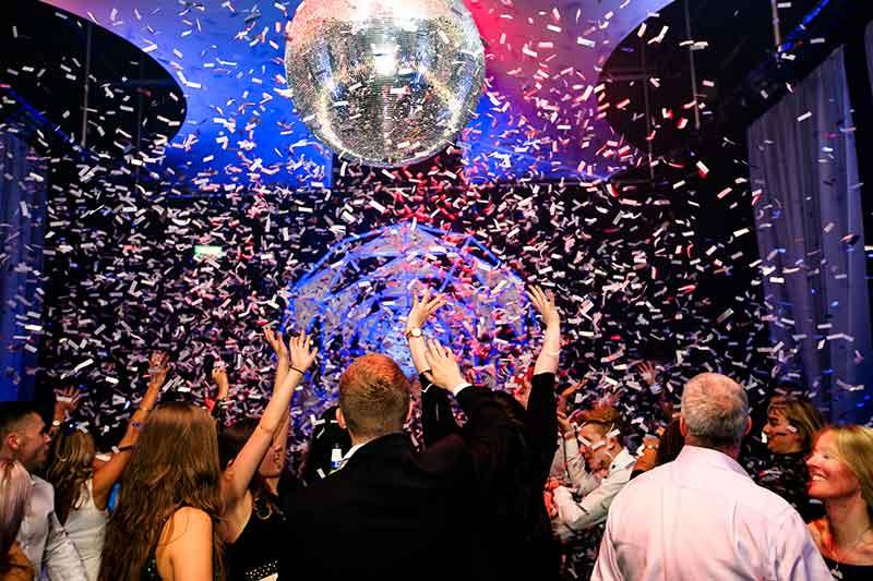 Party confetti drop on a dancefloor