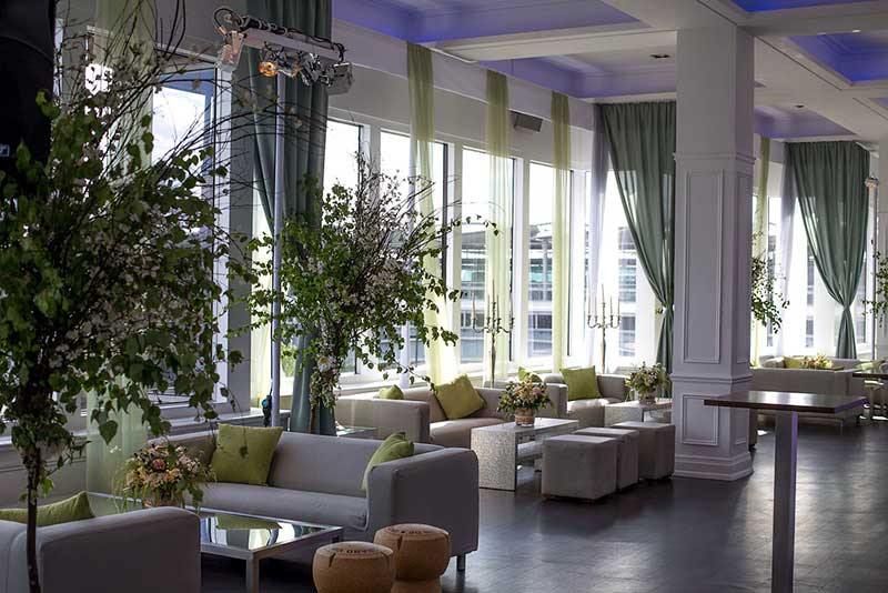 Stylish wedding venue seating area with floral displays overlooking the Thames